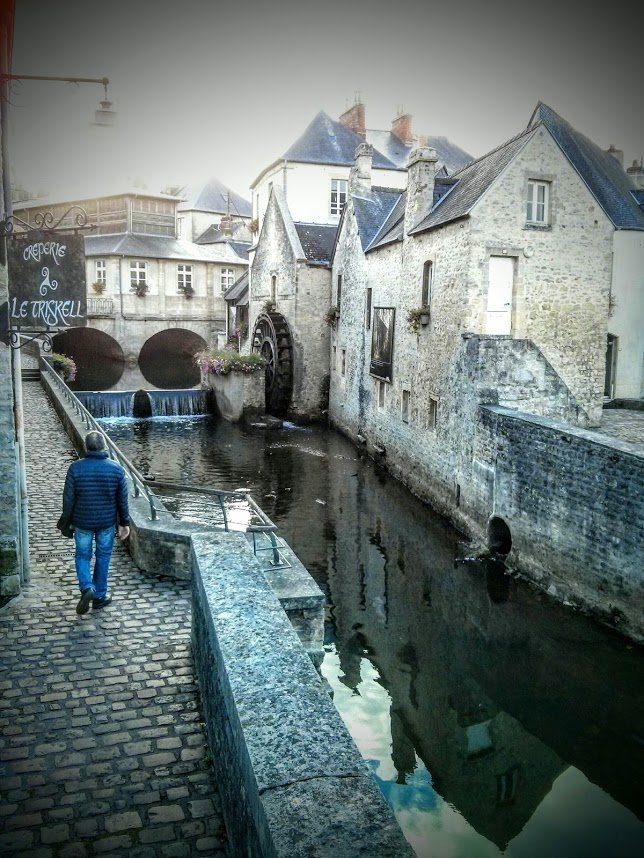 Walking along the canal in Bayeaux Normandy